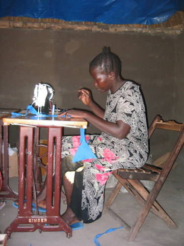 A woman sewing with sewing machine